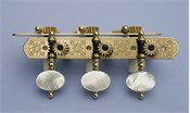 L333: Rodgers style engraved brass side plates, light mop oval buttons, cream colored rollers