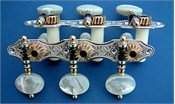 L179: Hauser style engraved sterling silver side plates, light mop oval buttons, cream colored rollers