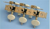 D110: Baker style engraved brass side plates, reverse gearing, synthetic ivory oval buttons, cream colored rollers