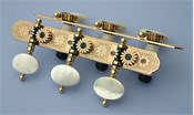 L330: Rodgers style engraved brass side plates, light mop oval buttons, cream colored rollers with self aligning bearing bushes